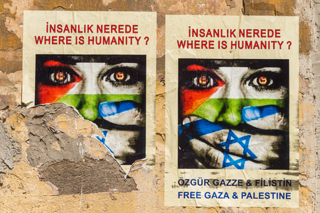 Posters on a street wall urge for a free Gaza and Palestine. Photo taken July 27, 2014 in Istanbul, Turkey.
