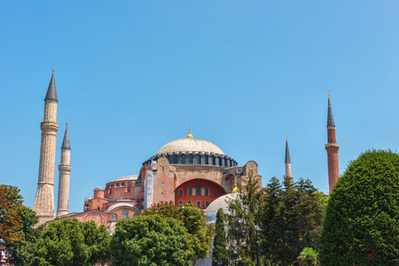 exists: The Hagia Sophia is a famous landmark in Istanbul, Turkey. Founded first as a Christian church, it was later converted to a mosque, and exists today as a museum. Stock Photo