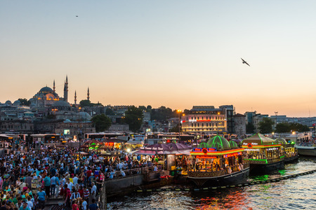 suleymaniye: Hundreds of tourists and local Turks hang out along the Bosphorus as night comes on in Istanbul, Turkey