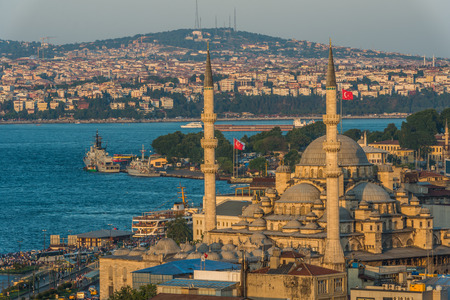cami: The New Mosque  Yeni Cami  among the Istanbul cityscape in early evening  Stock Photo