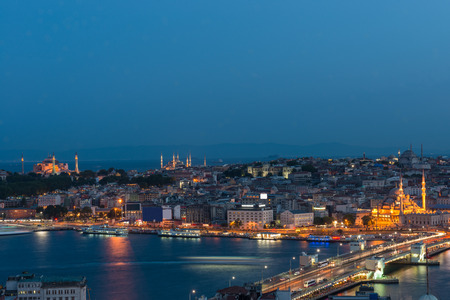 aya: Looking toward Istanbuls old city at night, with Galata Bridge in the foreground, and the Hagia Sophia and Blue Mosque in the distance.