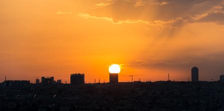 orange sunset: The skyline of Istanbul lit up against a brilliant orange sunset.