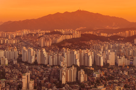 settles: Dusk settles over the endless cityscape of Seoul, South Korea. Stock Photo