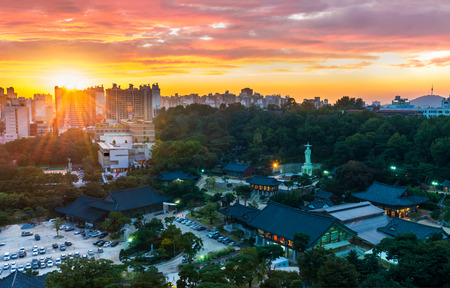 The lights turn on at Bongeunsa Temple as the sun sets over Seoul, South Korea.