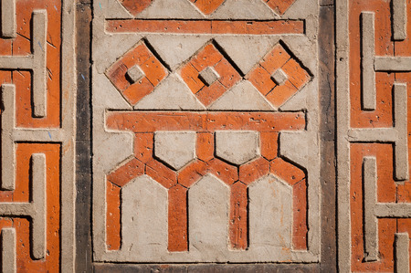 korean culture: Ancient patterns and symbols on a wall at Gyeongbokgung Palace in Seoul, South Korea. Stock Photo