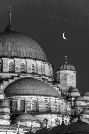 crescent moon: A crescent moon hangs over the New Mosque (Yeni Cami) of Istanbul, Turkey.