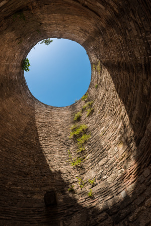 cistern: Looking up through a hole in the top of the old city walls in Istanbul, Turkey.