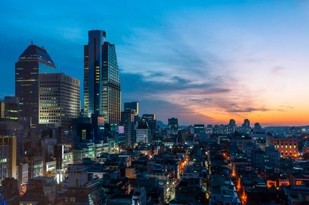 The sun sets over the Gangnam district of Seoul, South Korea.