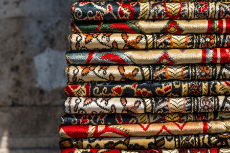 hand woven: Piles of hand woven rugs at the Grand Bazaar in Istanbul, Turkey.
