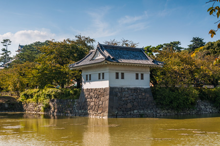 odawara: A guard tower stands at the edge of the moat surrounding Odawara Castle in Odawara, Japan.