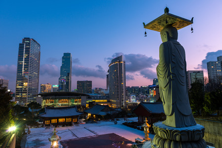 bongeunsa: A giant Buddha statue looks out over downtown Seoul at sunset from Bongeunsa Temple.