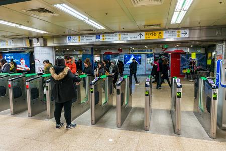 gangnam: Local Seoulites swipe their metro cards at Gangnam Station on December 21, 2014 in Seoul, South Korea.