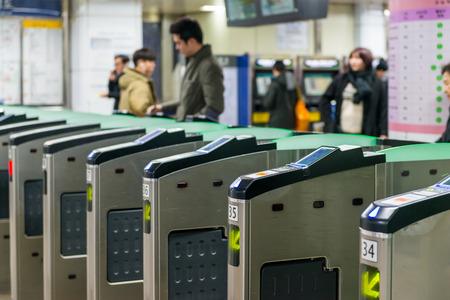 Local Seoulites swipe their metro cards at Gangnam Station on December 21, 2014 in Seoul, South Korea.