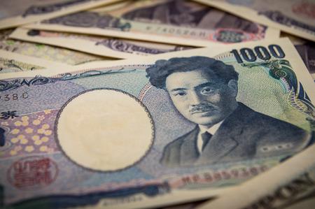 yen note: Closeup of a pile of Japanese yen.