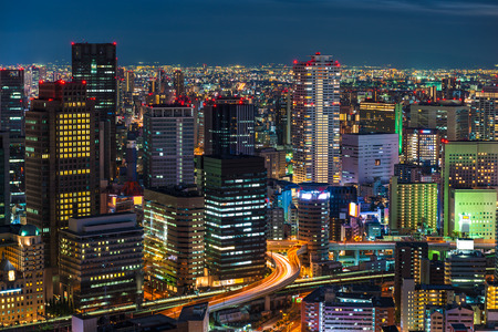 The lights of Osaka turn on as evening settles in over the city.