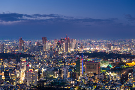 urban sprawl: The sun sets over the sprawling cityscape of Tokyo. Stock Photo