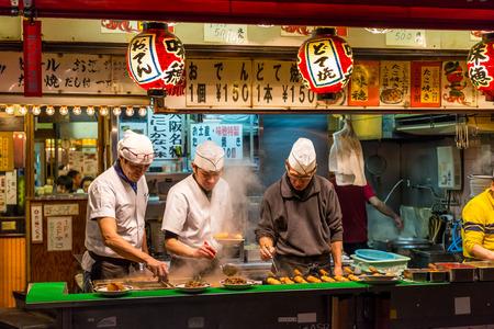 Men cook traditional Japanese street food on December 27, 2014 in Osaka, Japan. Editöryel