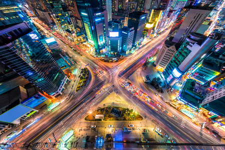 aerial view city: Looking down on a major interstection at night in Seoul, South Korea. Stock Photo