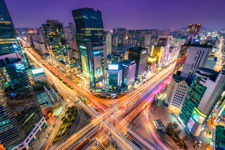 Night traffic zips through an intersection in the Gangnam district of Seoul, South Korea. Stock Photo