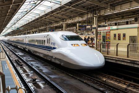 A Shinkansen train pulls into Shin Osaka Station on December 29, 2014 in Osaka, Japan.