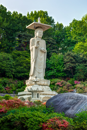 buddha tranquil: A giant Buddha statue looks out over Bongeunsa Temple in Seoul, South Korea.