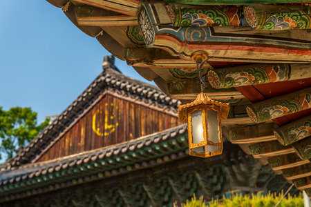 bongeunsa: A golden lantern hangs from the old eaves of Bongeunsa Temple in Seoul, South Korea. Stock Photo