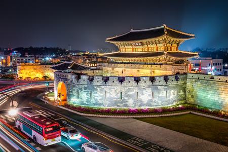 korean culture: Night traffic blurs past Janganmun Gate at Hwaseong Fortress in Suwon, South Korea.