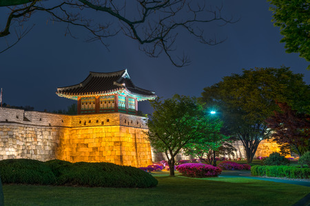 heritage protection: The old walls of Hwaseong Fortress lit up at night in Suwon, South Korea.