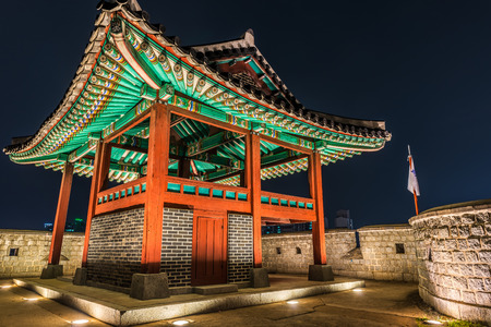 watchtower: A watchtower at Hwaseong Fortress lit up at night in Suwon, South Korea. Editorial