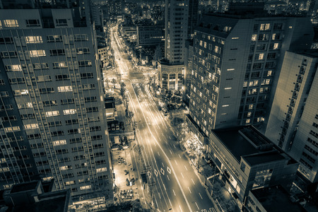 urban sprawl: Futuristic cityscape lit up at night.