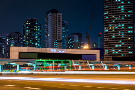 toll: Traffic blurs through a toll booth in Seoul, South Korea.