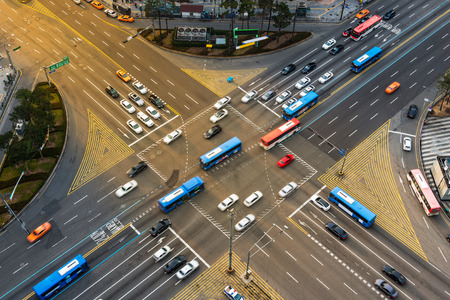 aerial: Rush hour traffic zips through an intersection in the Gangnam district of Seoul, South Korea.