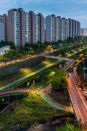 cutting through: Urban scenic of a pathway and river cutting through the suburbs of Seoul, South Korea.