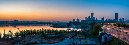 Panorama of the sun rising over the Han River and the National Assembly of South Korea in Seoul.