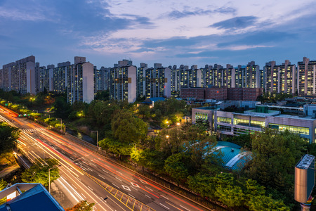 The sun sets over the endless apartment buildings among the suburbs of Seoul, South Korea. Stock Photo