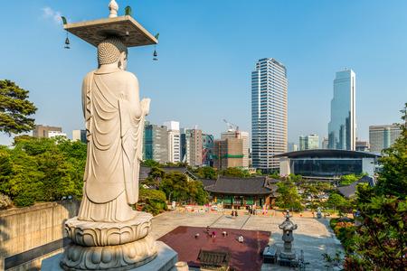 A giant Buddha statue looks out over Bongeunsa Temple in Seoul, South Korea. photo