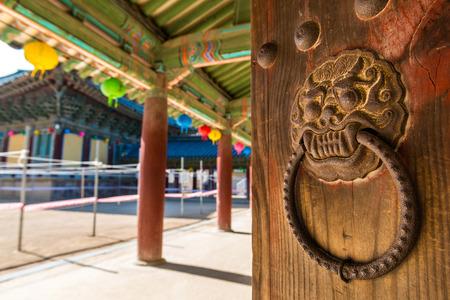 korean culture: An ornate door knocker at Bulguksa Temple in Gyeongju, South Korea. Stock Photo