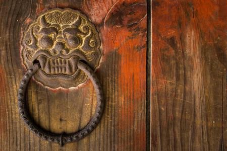ornate door: An ornate door knocker at Bulguksa Temple in Gyeongju, South Korea. Stock Photo