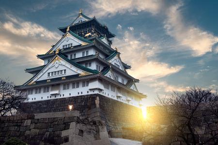 castle buildings: The sun sets behind Osaka Castle in Osaka, Japan.