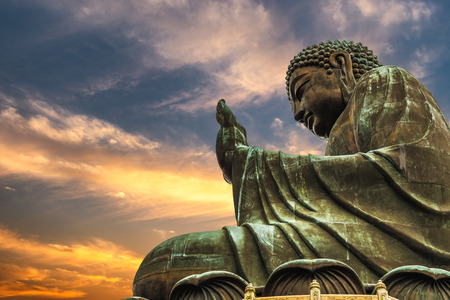 The enormous Tian Tan Buddha at Po Lin Monastery in Hong Kong. Banco de Imagens