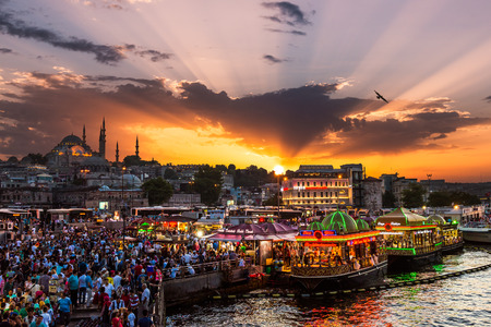 istanbul night: Hundreds of tourists and local Turks hang out along the Bosphorus as night comes on on July 29, 2014 in Istanbul, Turkey. Editorial