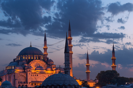 mosque: Suleymaniye Mosque lit up at dusk in Istanbul, Turkey. Stock Photo