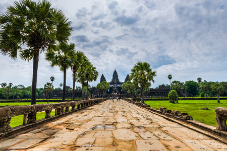 angkor wat: On the ancient stone road to Angkor Wat in Siem Reap, Cambodia. Stock Photo