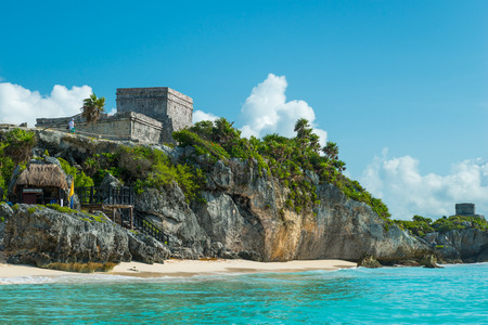 El Castillo, the central piece of the ancient Mayan ruins at Tulum, Mexico, sits atop the cliffside overlooking the Caribbean sea.