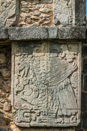itza: Engravings such as this eagle cover the Mayan ruins of Chichen Itza in Mexico.