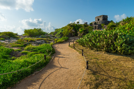 history building: The ancient Mayan ruins of Tulum sit atop the cliffs of Tulum, Mexico, overlooking the Caribbean sea.