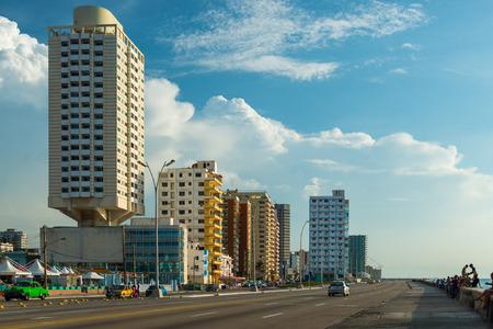 havana cuba: The old architecture of Havana, Cuba, stands across from the Malecon, a long boardwalk that runs along the Caribbean sea.