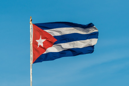 A Cuban flag flies high above the city of Havana.