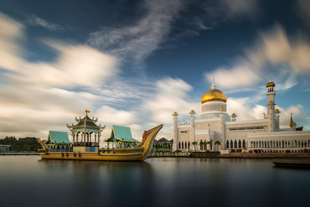 Long exposure of the clouds drifiting over Sultan Omar Ali Saifuddin Mosque in Bandar Seri Begawan, Brunei. Stock Photo