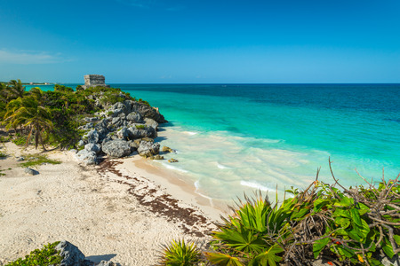 tulum: The ancient Mayan ruins of Tulum, Mexico, sit atop the cliffside overlooking the Caribbean sea.